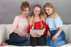 Three women using tablet Royalty Free Stock Photo