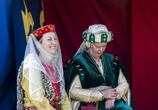Women sitting in tent. Medieval Display. Warkworth, Northumberland. England. UK. Stock Photography