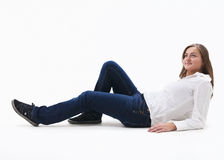 Women sitting on a white floor. Woman sitting of floor isolated Royalty Free Stock Image