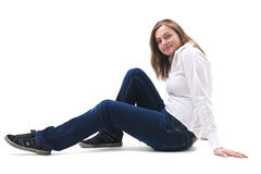 Women sitting on a white floor. Woman sitting of floor isolated Royalty Free Stock Photo