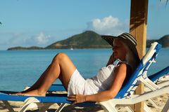 Women sittting on the chair and looking at the sea Stock Photos