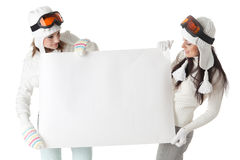 Women in ski glasses with board for text. Stock Image