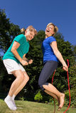 Women with a skipping rope. Women skipping a rope together Stock Image
