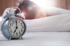 Women sleep in bed. And have an alarm clock stock photography