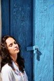 Women sleep under blue door on street in Campeche City Mexico stock images