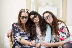 Women sleeping on sofa while wearing sunglasses Stock Images