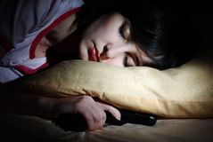 Women sleeps with the gun Royalty Free Stock Photo