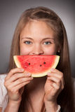 Women with a slice of melon Stock Photo
