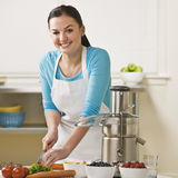 Women Slicing Produce Stock Photos