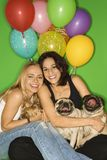Women with small dogs. royalty free stock photography