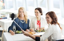 Women with smartphone taking selfie at restaurant Royalty Free Stock Photo