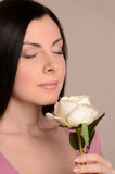 Women smelling the flower aroma. Portrait of beautiful middle-aged women smelling the white rose royalty free stock images