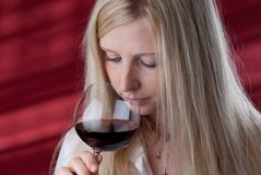 Women smelling red wine. Royalty Free Stock Image