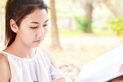 Women smile and drawing in the park. royalty free stock photography