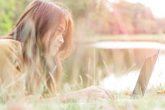 Women smile feel happy use laptop computer outdoor Stock Image