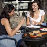 Women smiling during BBQ Royalty Free Stock Photography