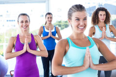 Women smiling in fitness studio with hands together Royalty Free Stock Photo