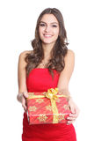 Women smiling with a gift in her hand Royalty Free Stock Photography