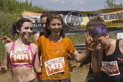 Women smiling after the mud run Stock Photos