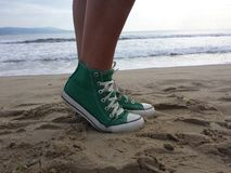 Women sneakers in beach Royalty Free Stock Photo