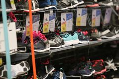 Women sneakers on a shelf in the French sporting goods retailer Decathlon. Bucharest, Romania - January 12, 2019: Domyos brand women sneakers on a shelf in the stock photo