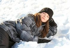 Women on snow. Women relaxing on snow during winter Royalty Free Stock Photography