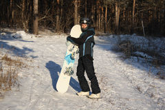 The women with a snowboard Stock Images