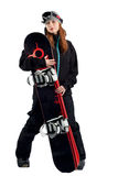 The women snowboarder in the goggles. Snowboarder in a goggles holding his board Royalty Free Stock Image