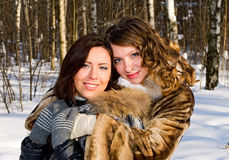 Women in snowy forest Stock Photo