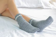 Women socks on bed. Women and beautiful socks in feet on bed stock photo