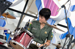 Women soldier playing drum Royalty Free Stock Photos