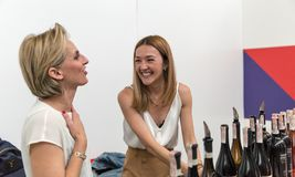 Kyiv Wine Festival by Good Wine in Ukraine. Women sommelier present wines at Kyiv Wine Festival booth. 77 winemakers from around the world took part in the big Royalty Free Stock Image