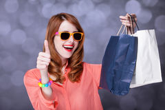 Women with sopping bags. Redhead woman with sopping bags. Studio shot royalty free stock images