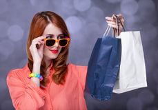 Women with sopping bags. Redhead woman with sopping bags. Studio shot stock images