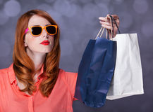 Women with sopping bags. Redhead woman with sopping bags. Studio shot stock photography