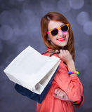 Women with sopping bags. Redhead woman with sopping bags. Studio shot royalty free stock image