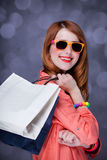 Women with sopping bags. Redhead woman with sopping bags. Studio shot stock image