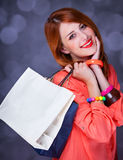 Women with sopping bags. Redhead woman with sopping bags. Studio shot royalty free stock photo