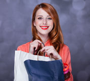 Women with sopping bags. Redhead woman with sopping bags. Studio shot royalty free stock photos