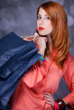 Women with sopping bags. Redhead woman with sopping bags. Studio shot royalty free stock photography