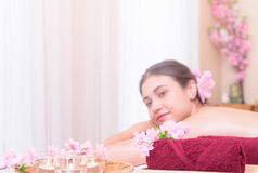 Women on Spa bed with Spa objects. On the foreground Royalty Free Stock Images