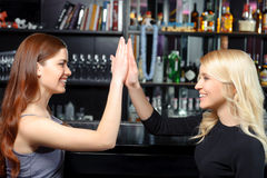 Women spend time in a bar Stock Photo