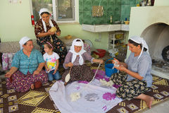 Women spin wool for carpet production in Karacahisar, Turkey. KARACAHISAR, TURKEY - AUGUST 14, 2009: Unidentified women spin wool for carpet production in royalty free stock photo