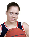 Women in sports. A young female student athlete holds a basketball set against a white background Stock Photography