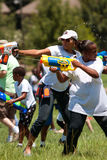 Women Squirt Opponents In Group Water Gun Fight Stock Photos