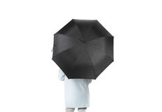Women stand backwards with black blank umbrella opened mockup. Clipping path. Female person hold clear umbel overhead. Plain surface gamp mockup. Man holding Stock Images