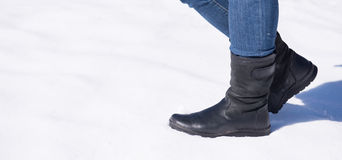 Women stand on snow Royalty Free Stock Photos