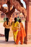 Women standing in Astrologer`s kiosk in Fatehpur Sikri, Uttar Pr. Adesh, India. Fatehpur Sikri is one of the best preserved examples of Mughal architecture in stock image