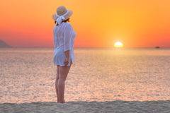 Women standing on the beach at beautiful sunset Royalty Free Stock Photography