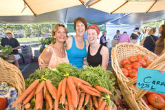 Women Standing Behind Vegetables - Horizontal Royalty Free Stock Photo
